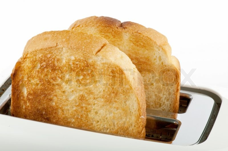 Toast In Toaster ~ Bread in the white toaster stock photo colourbox