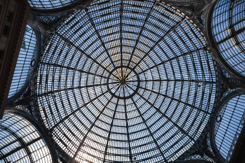 Stock image of 'Naples, Italy - August 9, 2015: Galleria Umberto I interior fragment, glass roof dome'