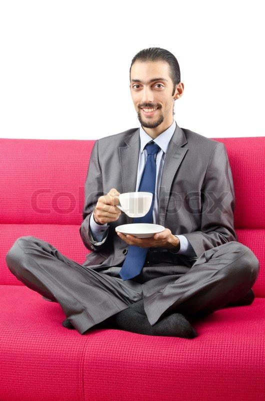 Man Sitting On The Sofa Stock Photo Colourbox