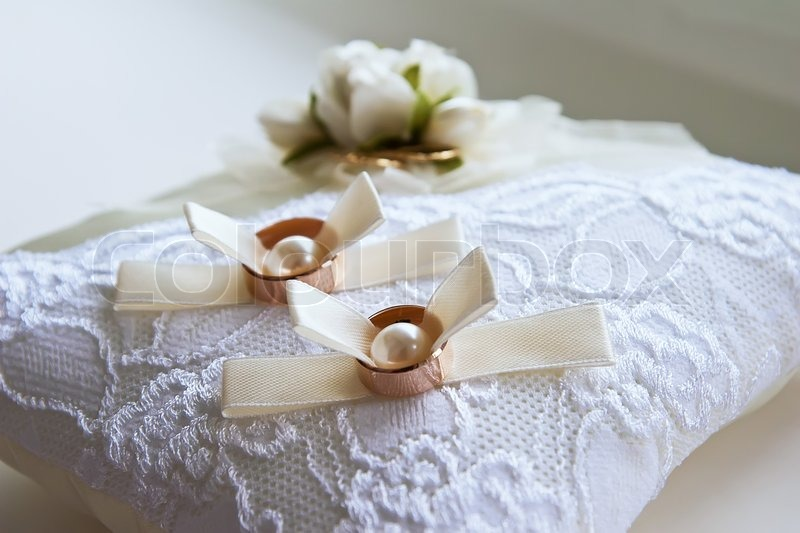 Two wedding rings with white flower in the background stock photo two wedding rings with white flower in the background stock photo colourbox mightylinksfo