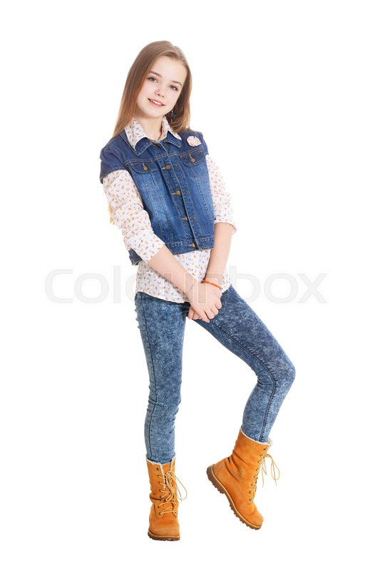 c38ed4aa7db Happy little girl in jeans posing isolated on white background