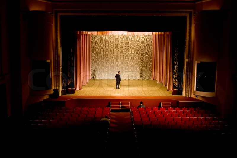 Stock Photo An Image Of A Man On The Stage In Empty Hall