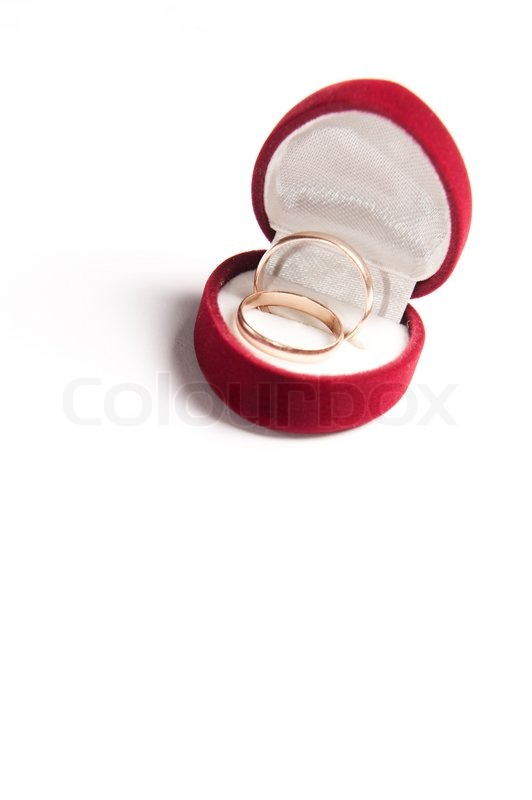 Heart shaped box with wedding rings on white background for Heart shaped engagement ring box