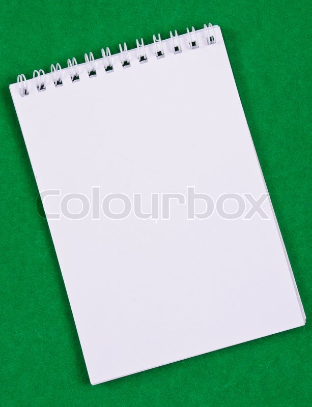 Pad of paper to take notes Photo on a colored background, stock photo