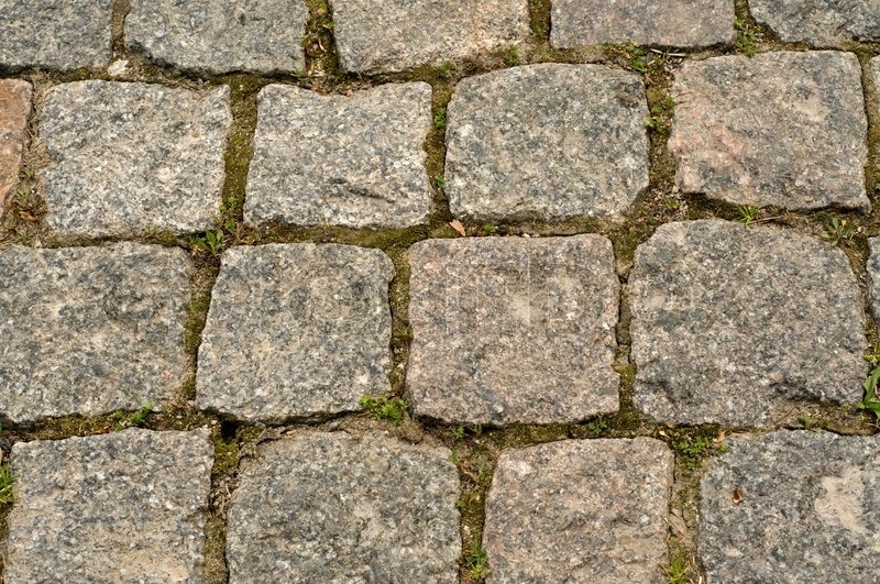 The road for walks in park is paved by a square stone, stock photo