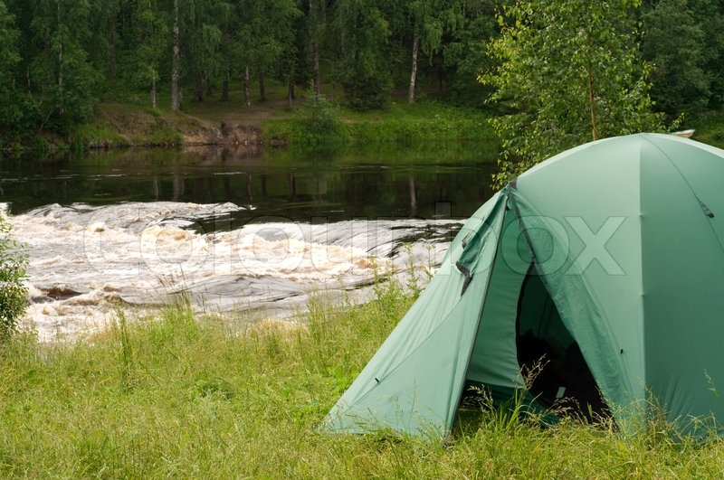 Tent set up for c&ing in the wood by a river | Stock Photo | Colourbox & Tent set up for camping in the wood by a river | Stock Photo ...