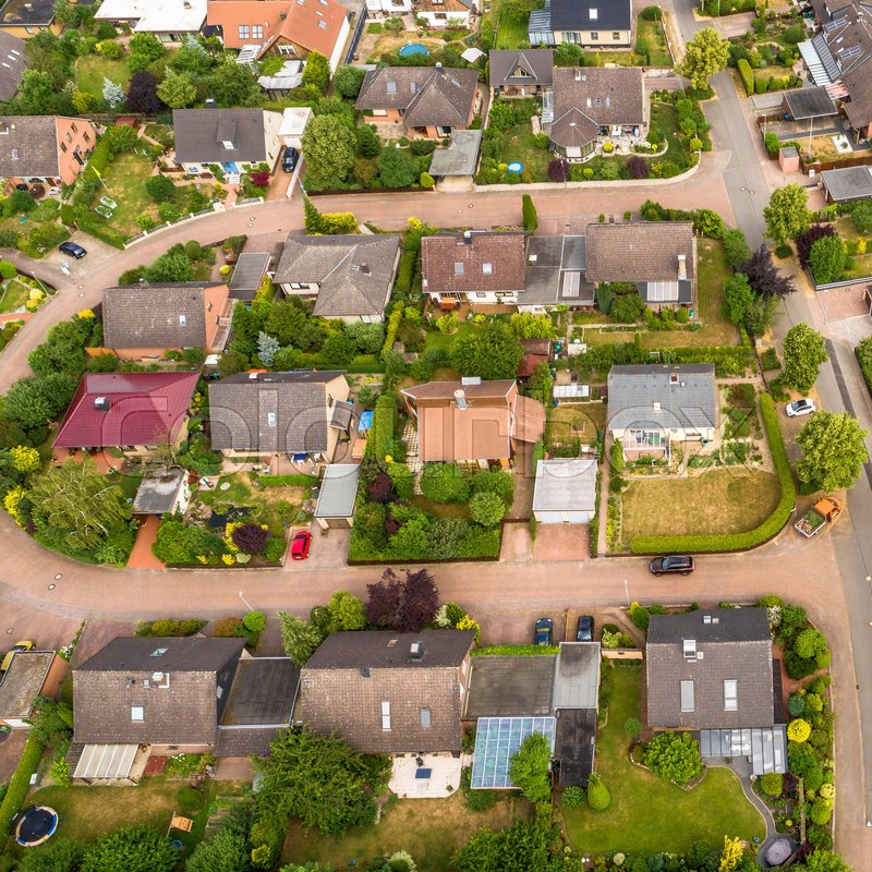 Typical German new housing development in the flat countryside of northern Germany between fields and meadows, made with drone, stock photo