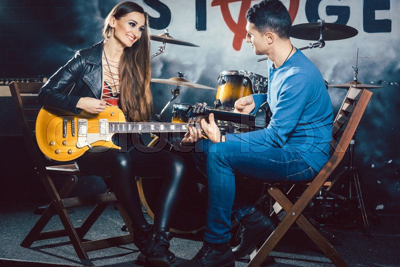 Beautiful Woman taking guitar lessons       Stock image