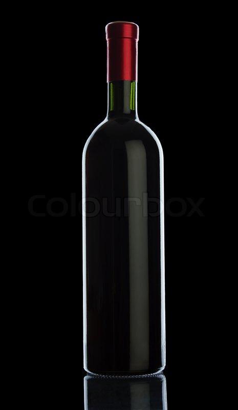 Bottle of wine isolated on black background | Stock Photo ...