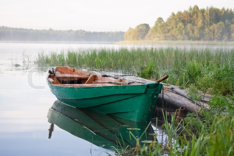 Wooden boat on the lake | Stock Photo | Colourbox