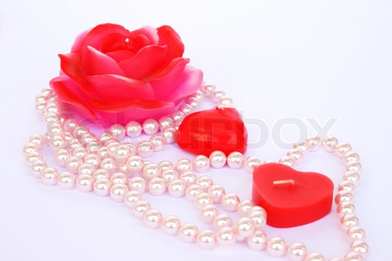 heart and rose shape red candles necklace isolated on grey