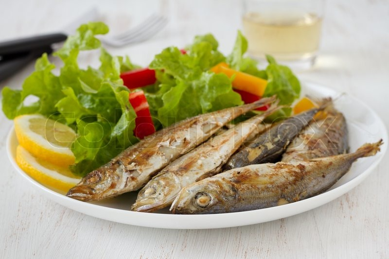 Fried fish with lemon and salad stock photo colourbox for Fish and salad