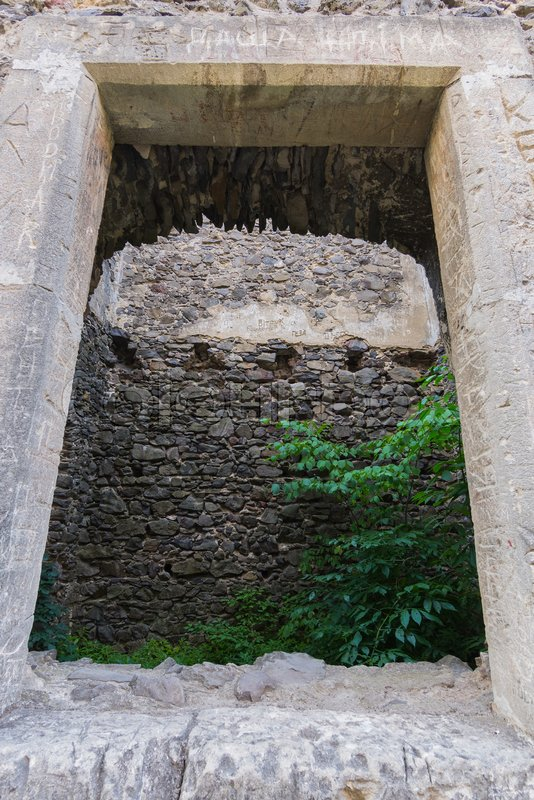 Stone old fortress wall with an opening in it. Historical value, stock photo