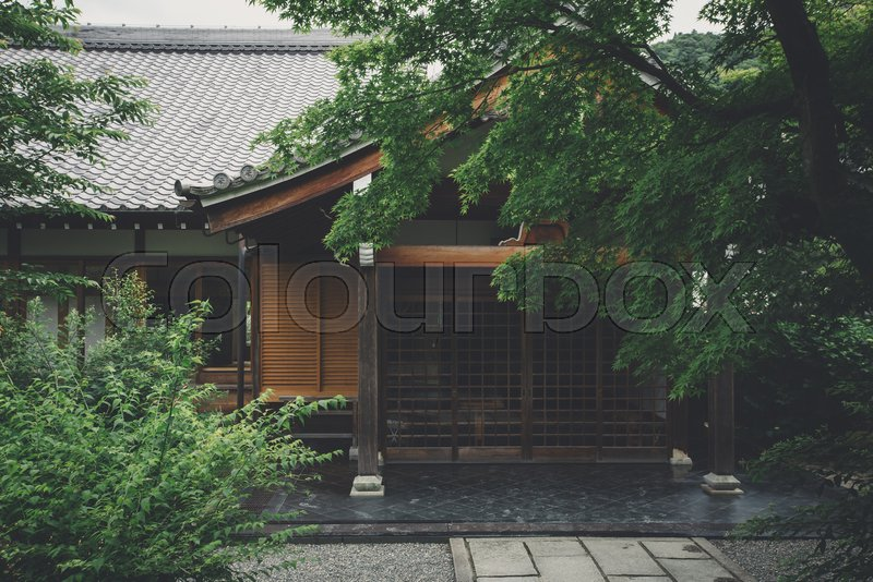 Japanese temple with japanese maple tree leaves in Kyoto vintage film style, stock photo