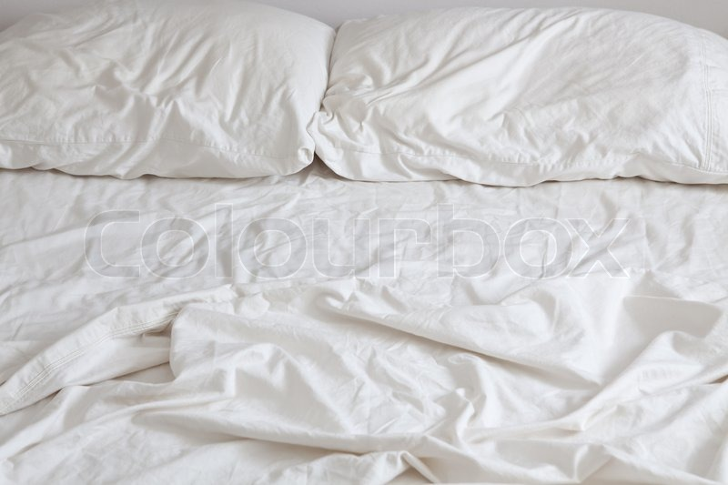 white bed sheets background. Empty Bed With Disheveled Pillows And Sheets, Stock Photo White Sheets Background
