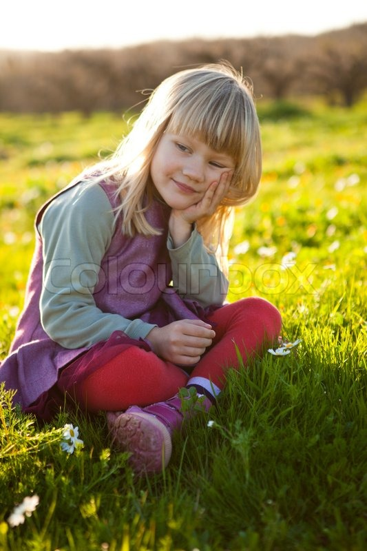 Cute Little Girl Outdoors Sitting On A Green Field With -9254