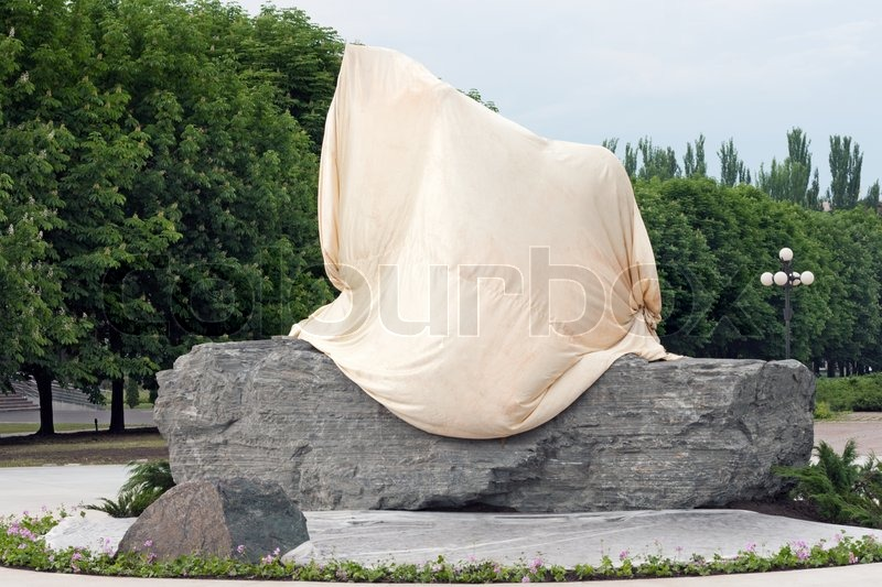 Stock image of 'Covered monument on granite pedestal'