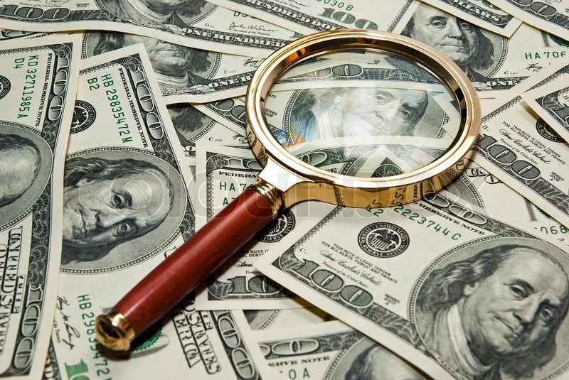 Magnifying glass on a dollar background   Stock image   Colourbox