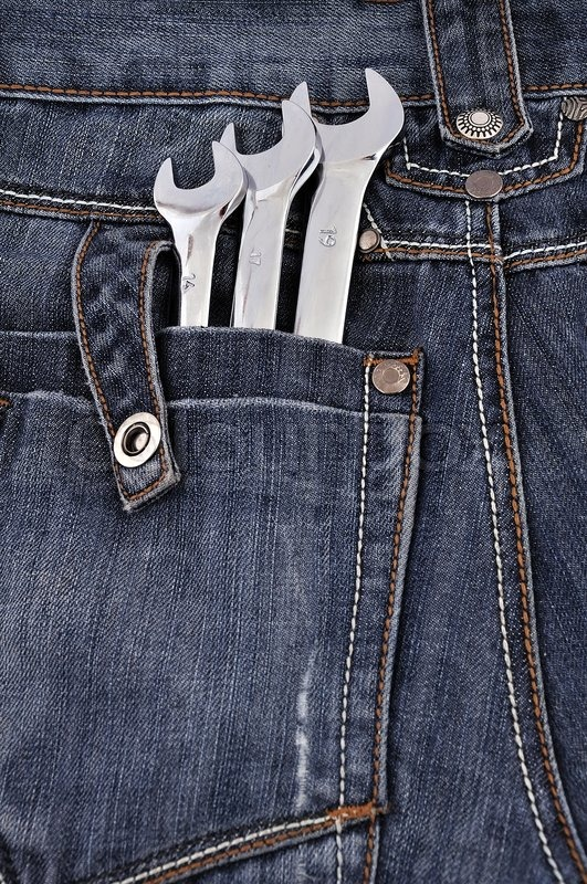 Spanners in the back pocket Jeans | Stock Photo | Colourbox
