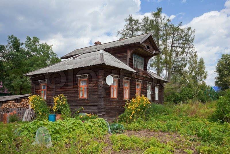 Old wooden house in russian village stock photo colourbox for Wood house images