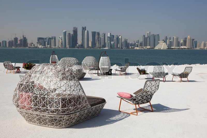 Cafe chairs with view of doha downtown skyline qatar