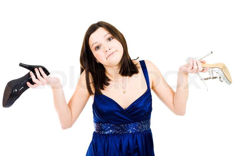 woman chosing betwen schwarze und wei e schuhe stehen im. Black Bedroom Furniture Sets. Home Design Ideas