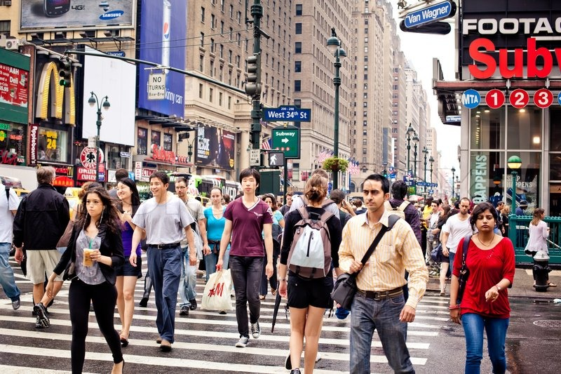 NEW YORK - JULY 3: People crossing the street on Seventh Avenue on July 3, 2011 at Manhattan, New York, stock photo
