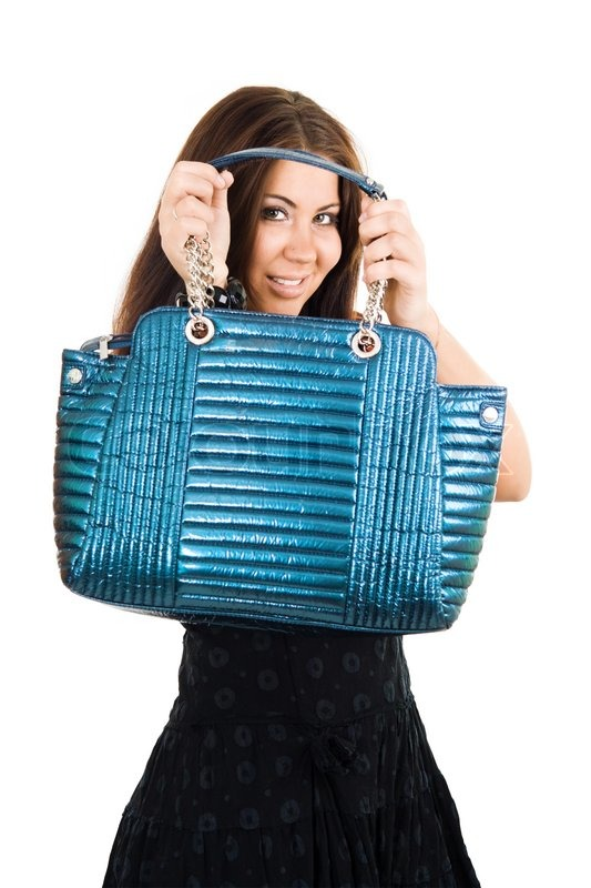 3d917e4a499 Young woman holding blue vivid handbag ...   Stock image   Colourbox