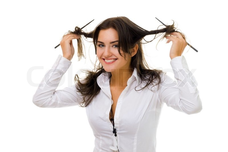 One young woman twirl her hair with sticks in white shirt smiling ...