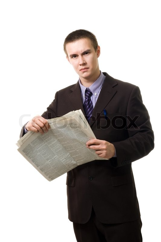 Confident Young Man Reading Newspaper Standing And Wearnig