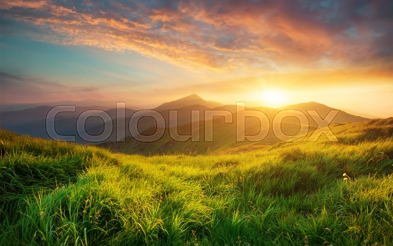 Mountain valley during sunrise. Natural ...