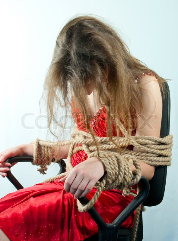 Woman Tied Up With A Rope Against Light   Stock Image -6556