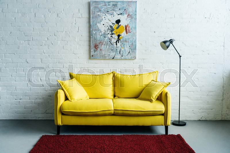 Interior Of Cozy Living Room With Painting On Wall, Sofa And Floor Lamp  Beside | Stock Photo | Colourbox