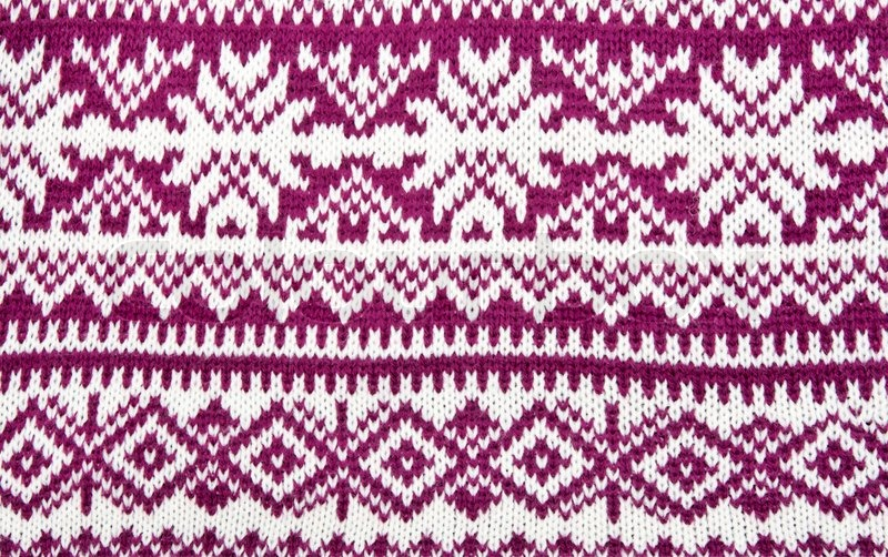 Knitted Colored Background With A Pattern In The Shape Of Snowflakes