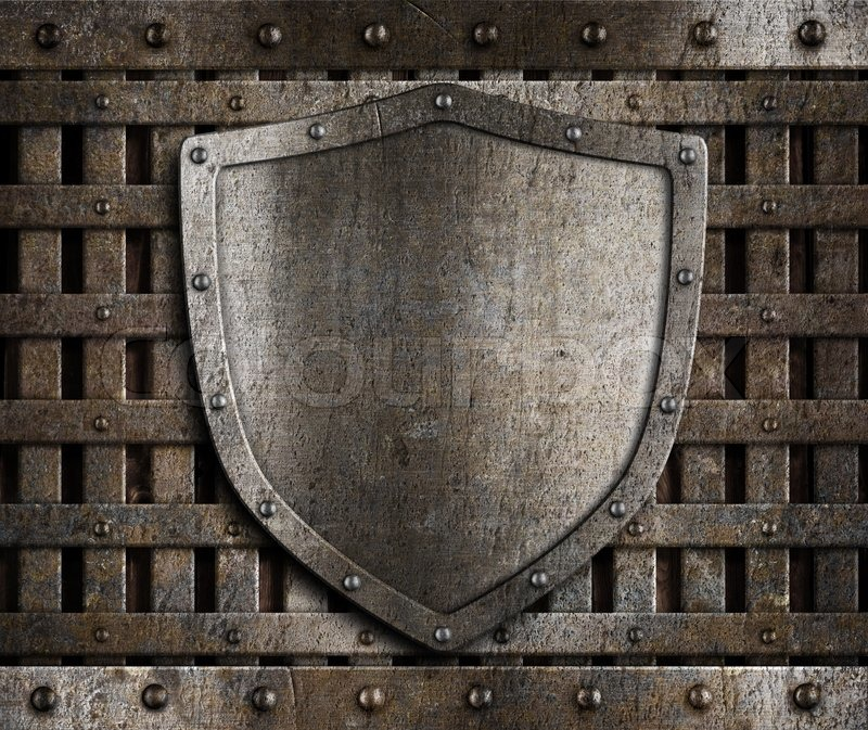 Aged Metal Shield On Wooden Medieval Gates Stock Photo