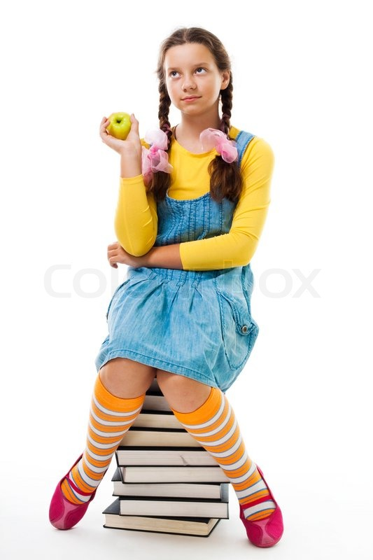 girl eat apple sitting on pile of books isolated on white play homeworlds pyramid online play homework music