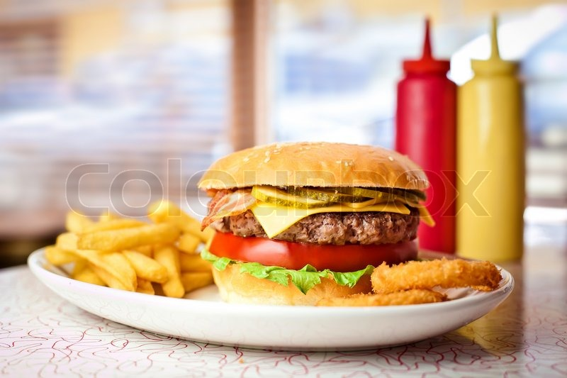 Close up of the fresh hamburger with french fries, stock photo