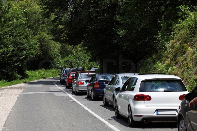Stock image of 'Cars in a traffic jam on a country road'