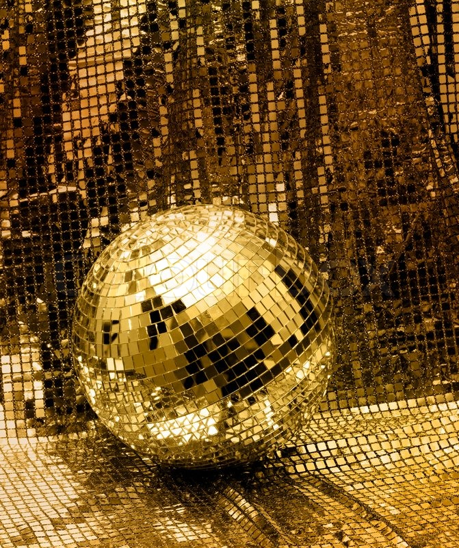 Golden disco mirror ball reflect light on glitter canvas ...