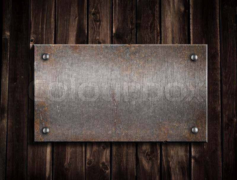 Rusty Metal Plate On Wooden Background Stock Photo