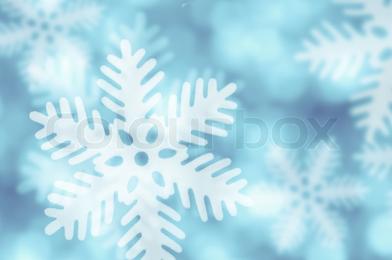 Stock image of 'Winter blue background with snowflakes falling'