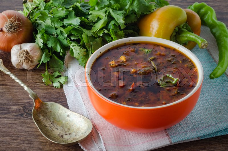 Stock image of 'Bowl of traditional soup Borscht on table'