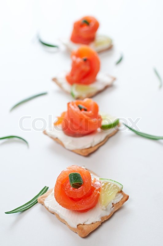 Canapes with smoked salmon and cream cheese on white for Canape suppliers