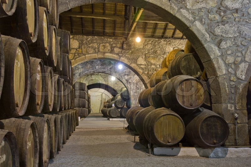 Old Cellar With Rows Of Wooden Wine Barrels Stock Photo Colourbox