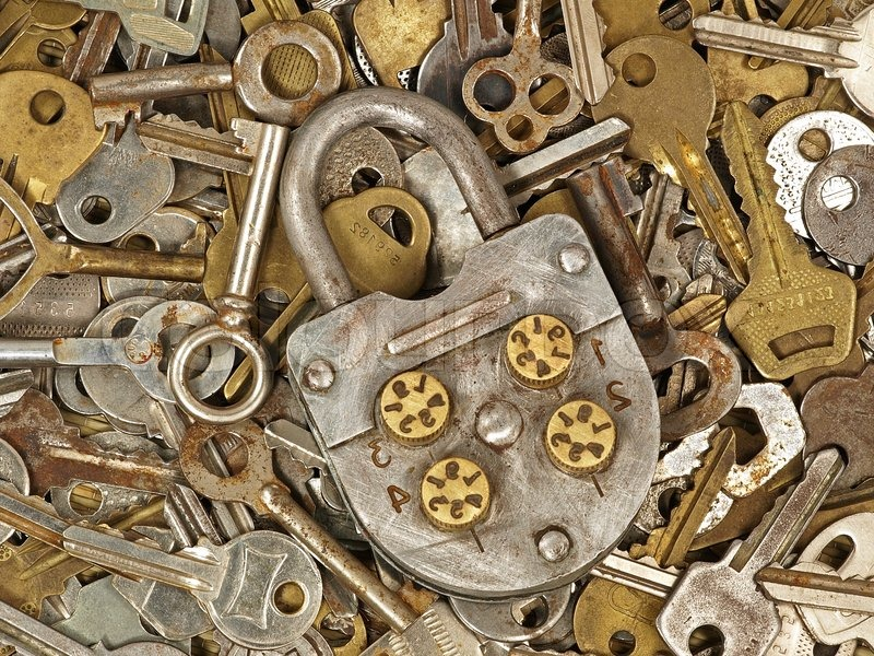 Old lock on a lot metal keys background     | Stock image | Colourbox