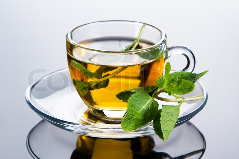 Tea cup with fresh mint leaves, closeup photo | Stock ...