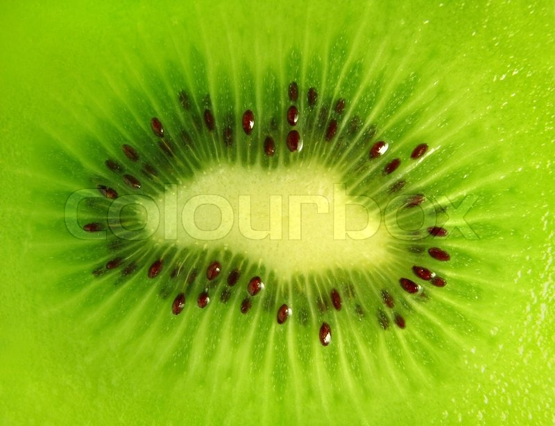 Kiwi fruit cut in half close up - Close Up Of A Kiwi Fruit Inside With Seeds Stock Photo