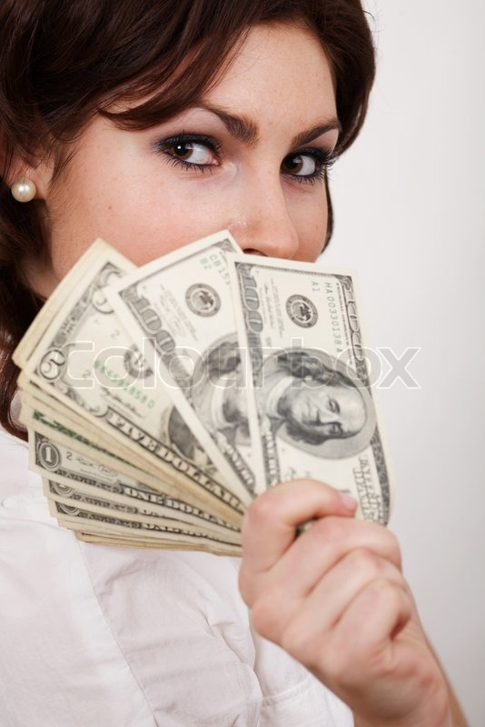 an image of businesswoman with money in hand stock photo colourbox