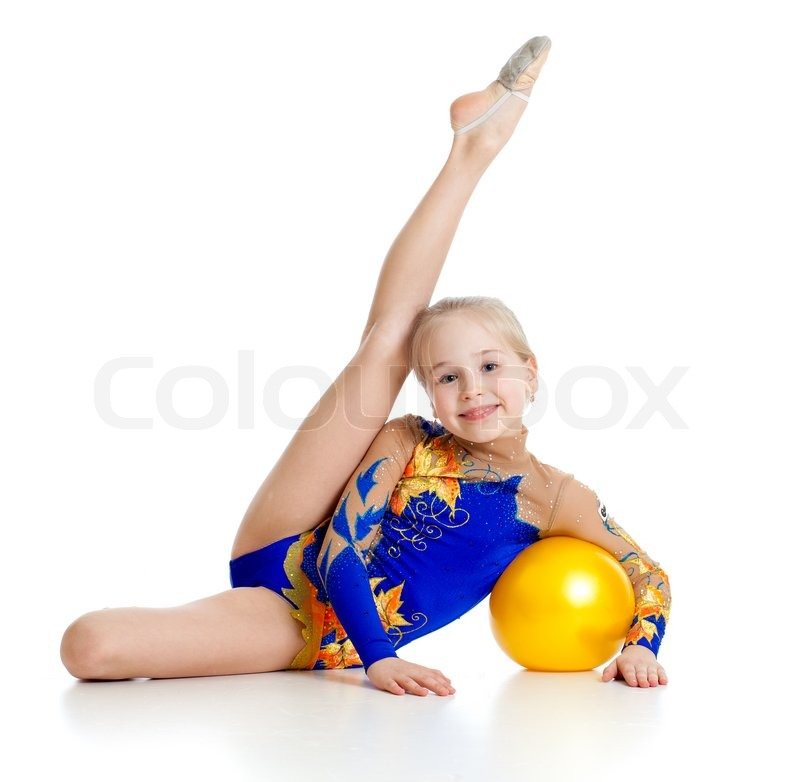 Pretty girl gymnast with yellow ball | Stock image | Colourbox