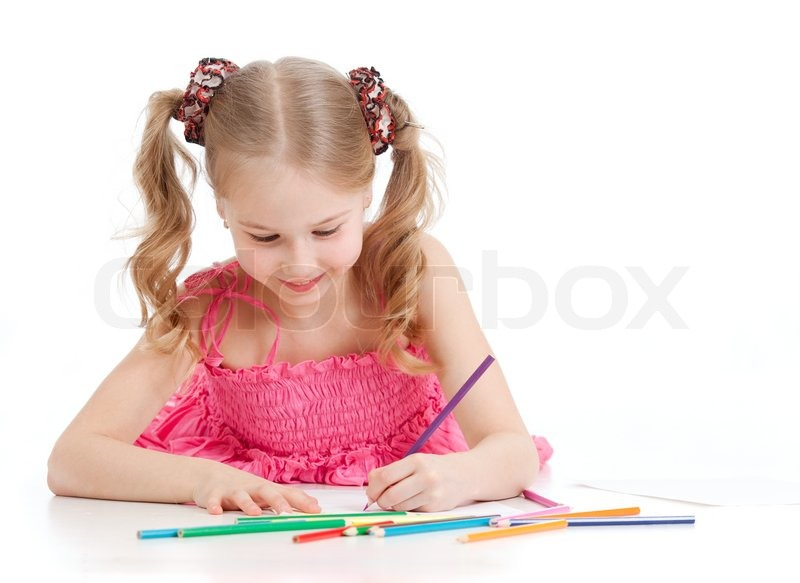 Happy girl drawing with pencils | Stock Photo | Colourbox